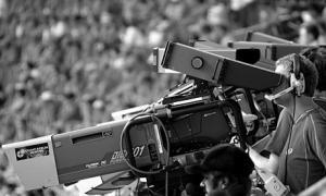Фотография оператора с камерой